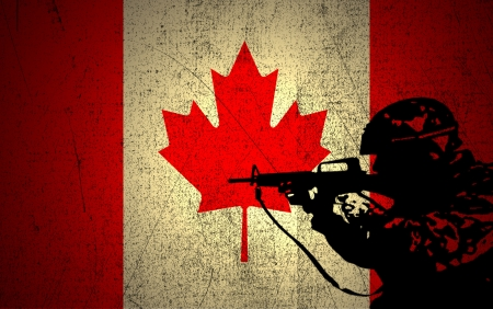 A silhouette of a soldier on the Grunge Canadian Flag photo