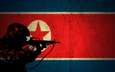 A silhouette of a soldier on the Grunge North Korea Flag photo
