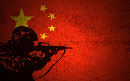 A silhouette of a soldier on the Grunge Chinese Flag photo