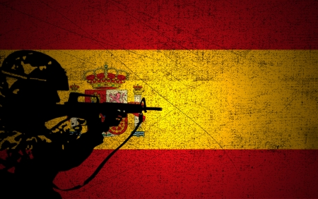 A silhouette of a soldier on the Grunge Spanish Flag photo