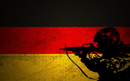 wartime: A silhouette of a soldier on the Grunge German Flag