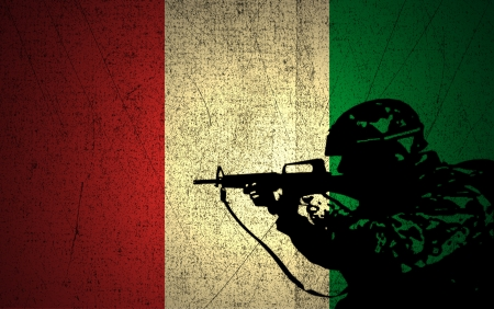 A silhouette of a soldier on the Grunge Italian Flag photo