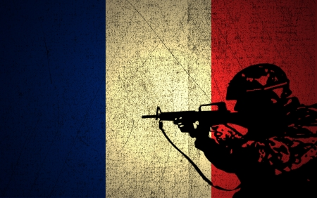 A silhouette of a soldier on the Grunge French Flag photo