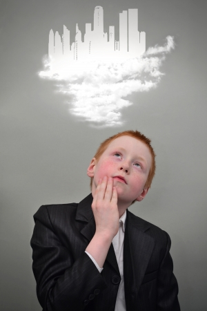 Young redhead boy dreams of the future