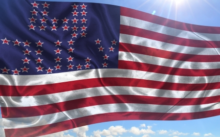 u s  flag: Waving American U S  flag on a background of blue sky and sun  Independence Day concept