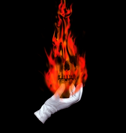 White glove holding a ball of fire on black background photo