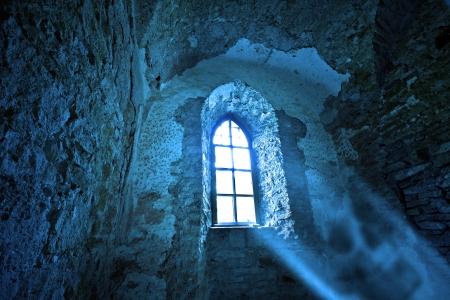 Mysterious window in the dark ancient castle
