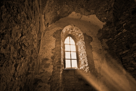 Mysterious window in the dark ancient castle photo