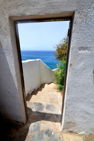 Doorway leading outdoors to the blue ocean photo