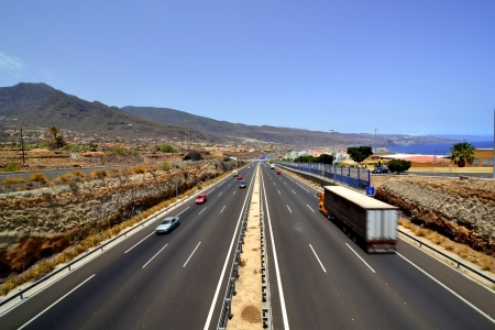 Panoramic view of a three-lane motorway near the sea coast photo