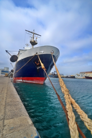 Fishing boat stands afloat in the sea port photo
