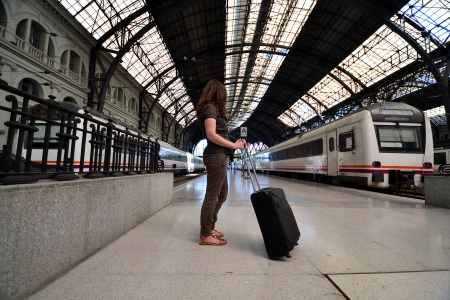 Girl standing on a platform of a railway station photo
