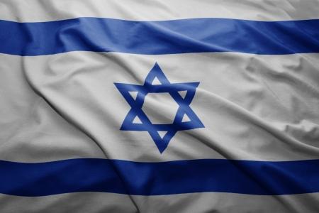 israel people: Waving colorful Israeli flag