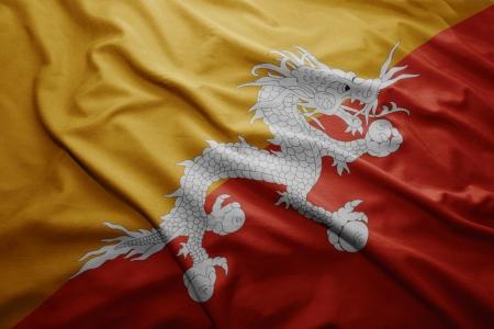 bhutan: Waving colorful Bhutan flag