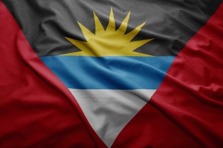 Waving colorful Antigua and Barbuda flag photo
