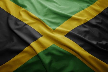 jamaican: Waving colorful Jamaican flag Stock Photo