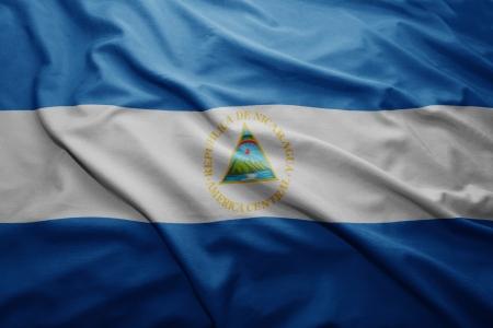 nicaraguan: Waving colorful Nicaraguan flag Stock Photo