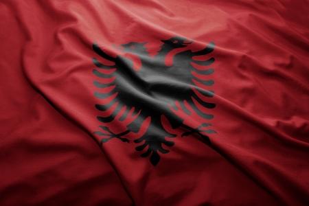 albanian: Waving colorful Albanian flag