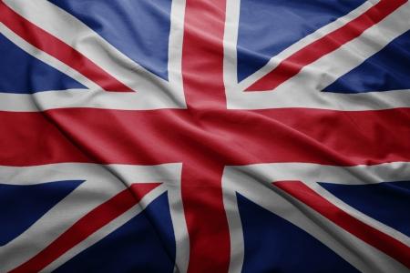 union jack flag: Waving colorful British flag