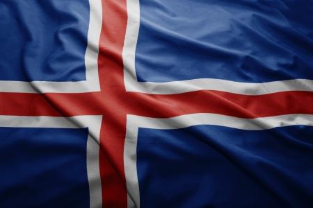 icelandic flag: Saludar con la mano colorida bandera islandesa