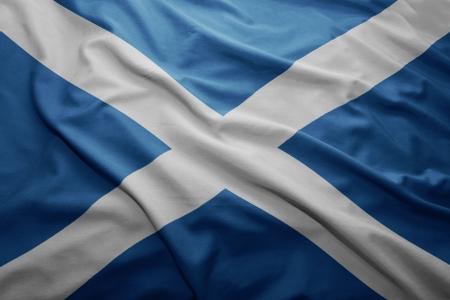 britain flag: Waving colorful Scottish flag Stock Photo