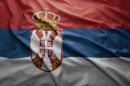 Waving colorful Serbian flag photo