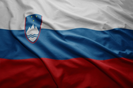 slovenian: Waving colorful Slovenian flag Stock Photo
