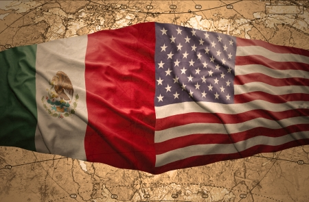 Waving United States of America and Mexican flags on the background of the political map of the world photo