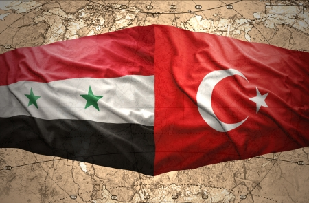 Waving Syrian and Turkish flags on the background of the political map of the world photo
