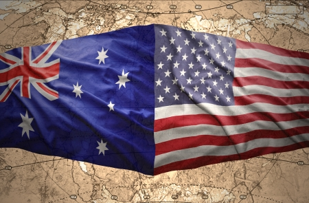 Waving United States of America and Australian flags on the background of the political map of the world photo