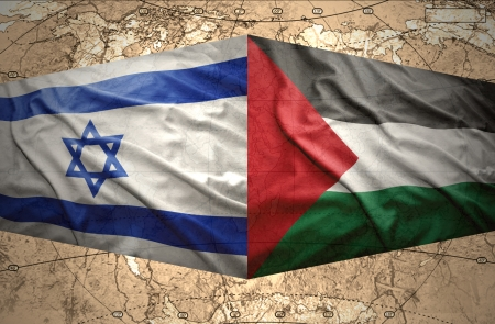 Waving Israeli and Palestinian flags on the political map of the world photo