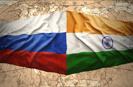 Waving Russian and Indian flags on the background of the political map of the world photo
