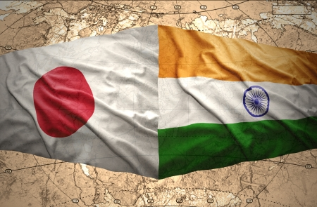 Waving Japanese and Indian flags on the background of the political map of the world