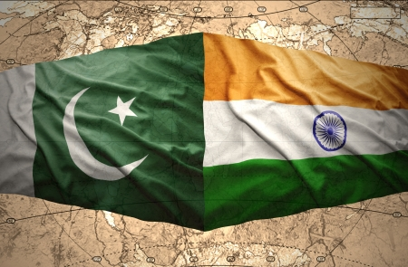 Waving Pakistani and Indian flags on the background of the political map of the world Stock Photo