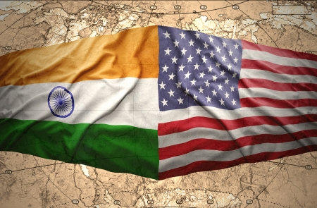 Waving United States of America and Indian flags on the background of the political map of the world photo