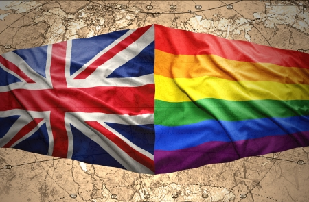 gay parade: Waving British and Rainbow flags on the background of the political map of the world Stock Photo