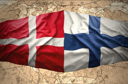 finnish: Waving Finnish and Danish flags on the background of the political map of the world