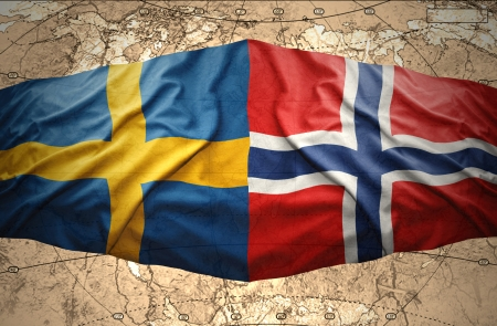Waving Norwegian and Swedish flags on the background of the political map of the world photo