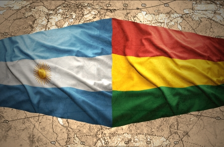 Waving Bolivian and Argentinean flags on the background of the political map of the world photo