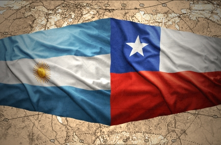 Waving Chilean and Argentinean flags on the background of the political map of the world photo