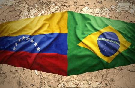venezuelan: Waving Brazilian and Venezuelan flags on the background of the political map of the world Stock Photo