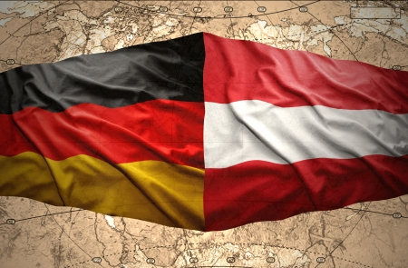 Waving Austrian and German flags on the background of the political map of the world photo