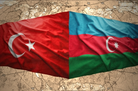 Waving Azerbaijani and Turkish flags on the background of the political map of the world Stock Photo - 24534379