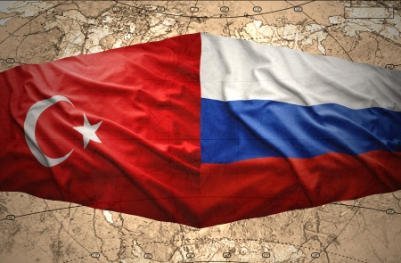 Waving Russian and Turkish flags on the background of the political map of the world Stock Photo