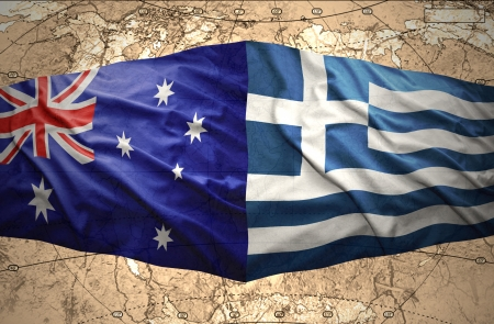 Waving Greek and Australian flags on the background of the political map of the world photo