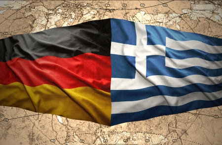 Waving Greek and German flags on the background of the political map of the world photo