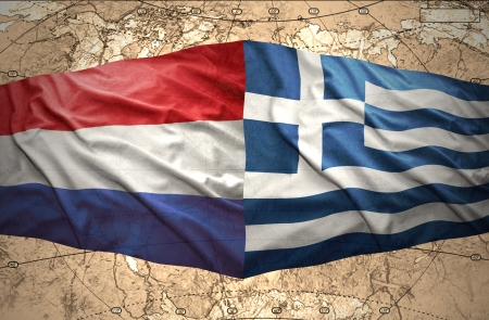 Waving Greek and Dutch flags on the background of the political map of the world photo