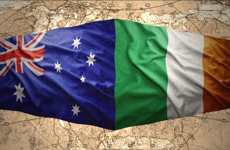 Waving Irish and Australian flags of the political map of the world photo