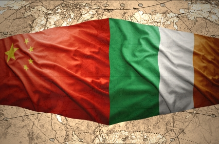 irish map: Waving Irish and Chinese flags of the political map of the world Stock Photo