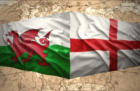 Waving English and Welsh flags of the political map of the world photo